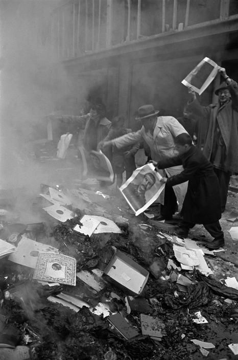 The Soviet Cultural shop - the Russian propaganda office - was stormed by the population who set fire to the Communist propaganda material. Budapest, 1956. Photo by Erich Lessing.