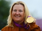 Kim Rhode won the gold medal in women's skeet shooting Sunday, making her the first American to take an individual-sport medal in five consecutive Olympics.