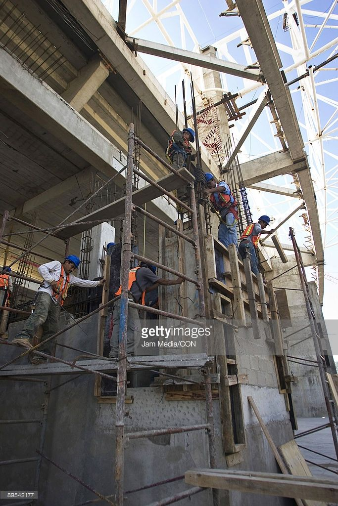View of men working on the construction of the new Chivas Guadalajara Stadium on July 30, 2009 in Guadalajara, Mexico.