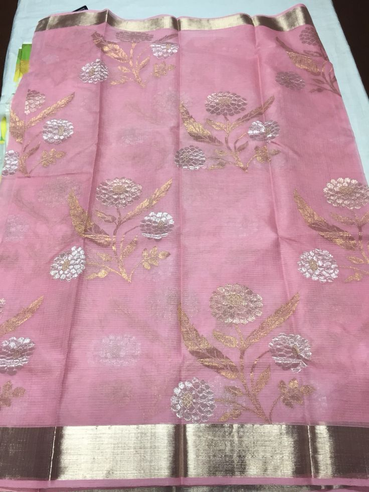 Baby pink pure zari kota with all over gold and silver floral bunches