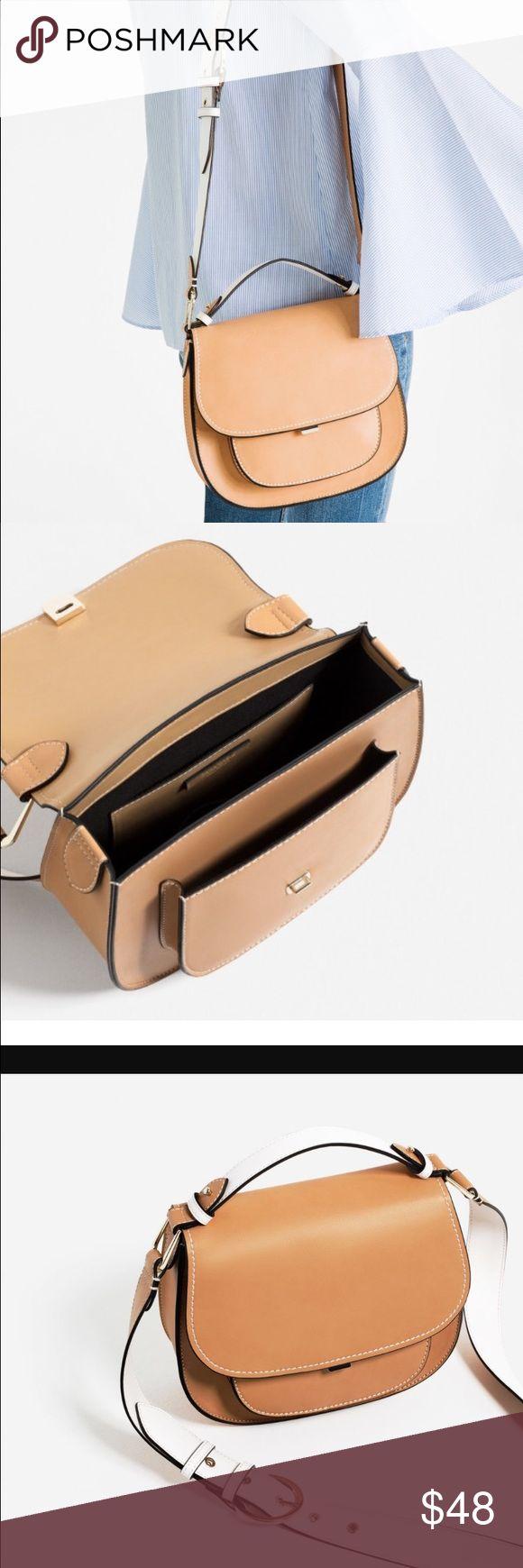 Zara crossbody bag. Brand new. Contrast strap crossbody bag. Impulse buy I realized I don't need. Never used.  Outside is polyurethane. Zara Bags Crossbody Bags