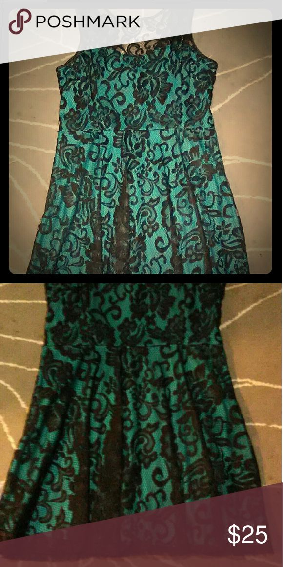 Classy black and teal lace dress Black lace with teal lining, just above knee length, very flattering for voluptuous beauties, and very very comfortable. Sally USA Dresses