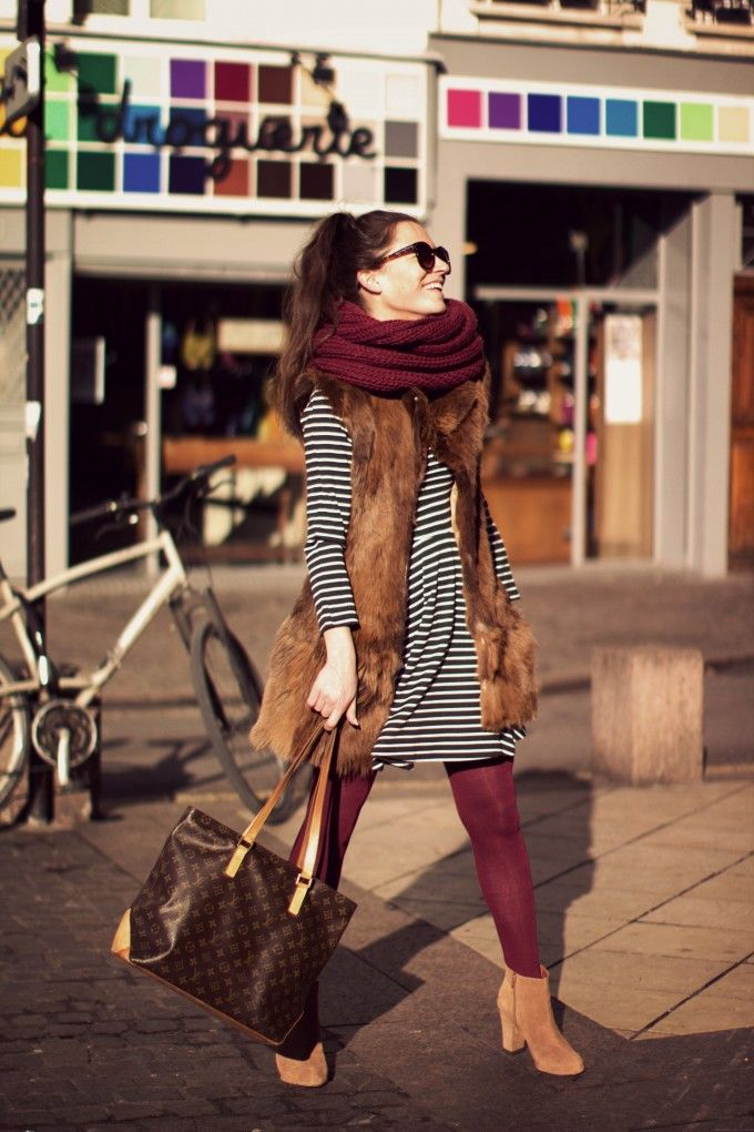 Pair a striped dress with a fur vest and matching thick scarf + tights