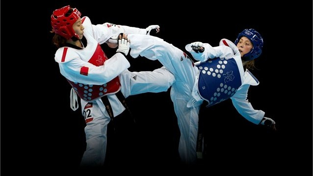 Jade Jones (R) of Great Britain competes against Hou Yuzhuo (L) of China during the Women's -57kg Taekwondo gold medal final on Day 13 of the London 2012 Olympic Games at ExCeL