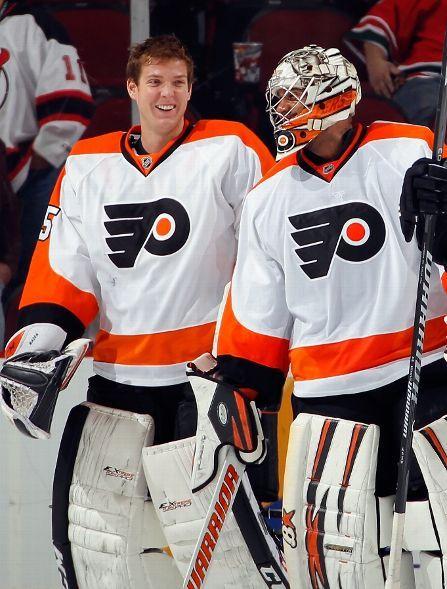 NEWARK, NJ - NOVEMBER 02: Goalies Steve Mason #35 and Ray Emery #29 of the Philadelphia Flyers skate off the ice smiling after a 1-0 shutout...