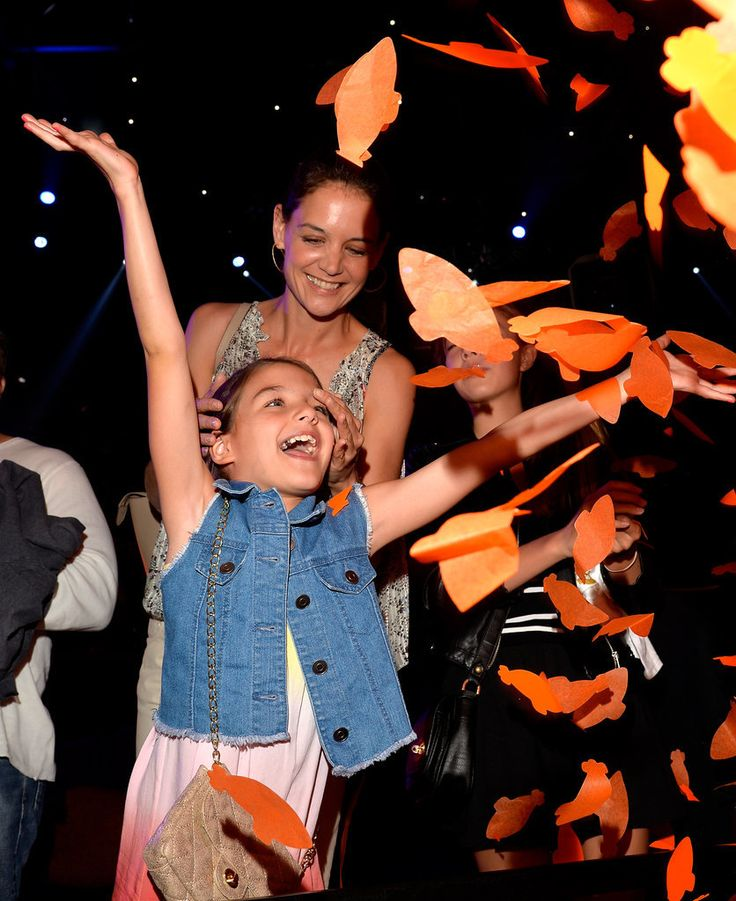 Katie Holmes and Suri Cruise had a blast at the Kids' Choice Awards. All the cute pictures will show you just how much Suri looks like her famous mom and dad.