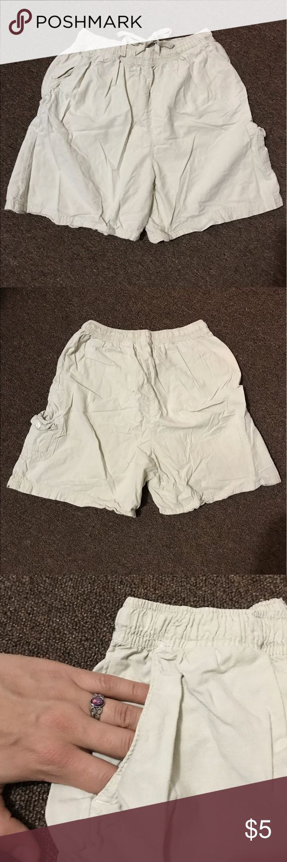 Khaki Cargo Shorts Gently used Khaki cargo shorts. Lots of pockets and very roomy! Please comment for q&a! Offers considered! Ragtop USA Shorts Cargos