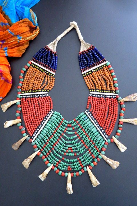Drapes of colorful beads in this dramatic ethnic necklace from Nagaland.