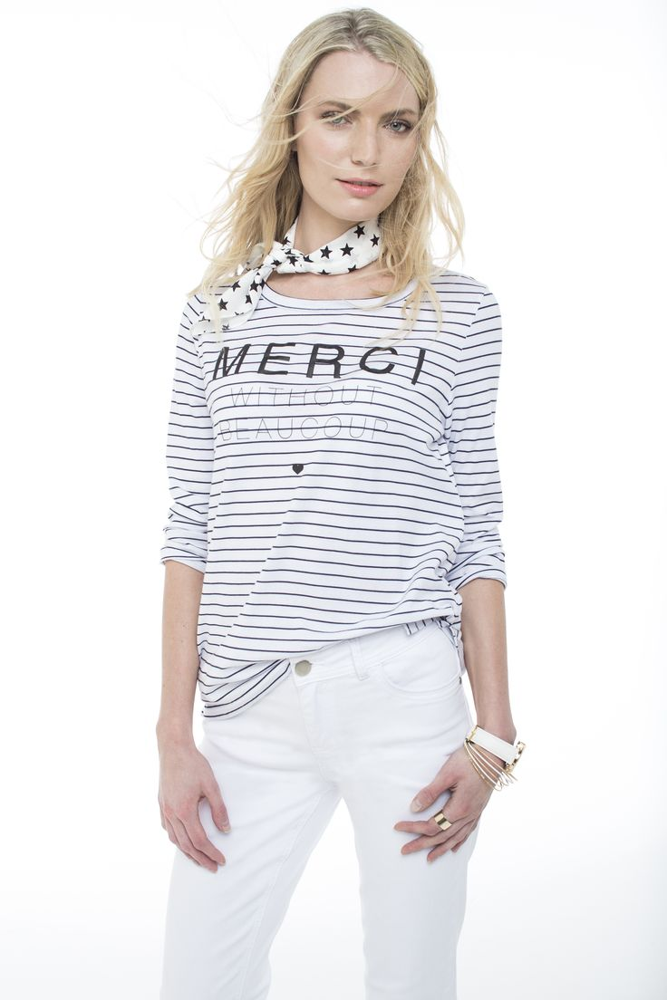 Classic at its best. The striped long sleeved tee worn with slim flare white denims.
