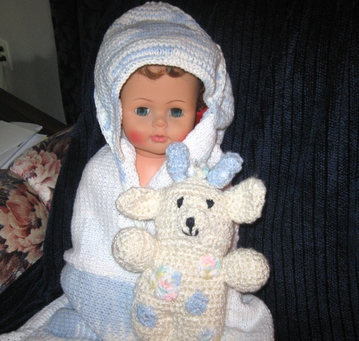Knitted hooded towel with matching face cloth $20.00 for the set.  Doll not included (it's older than me)!
