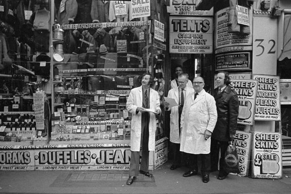 Shopkeepers come out to watch an anti-racism march in Hackney - Tony Bock 1970s