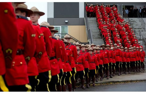 RCMP officers line up to march to a regimental funeral for RCMP Cnst. Adrian Oliver in Langley, B.C., on Tuesday, November 20, 2012. Oliver died November 13