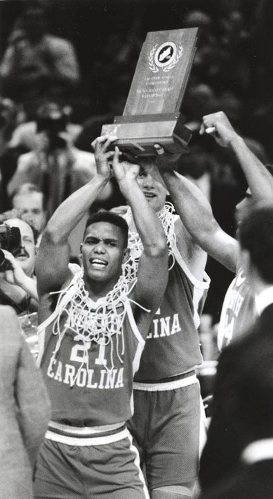 UNC'S King Rice hoists the ACC Men's Basketball Tournament chapionship trophy after the Tar Heels defeated the Duke Blue Devils 96-74 at the Charlotte Coliseum in Charlotte, NC on March 10, 1991 in the final game of the 1991 ACC Men's Basketball tournament.