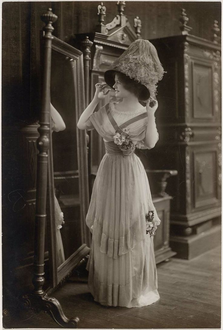 ~Circa 1910 lady in a fashionable dress and hat~