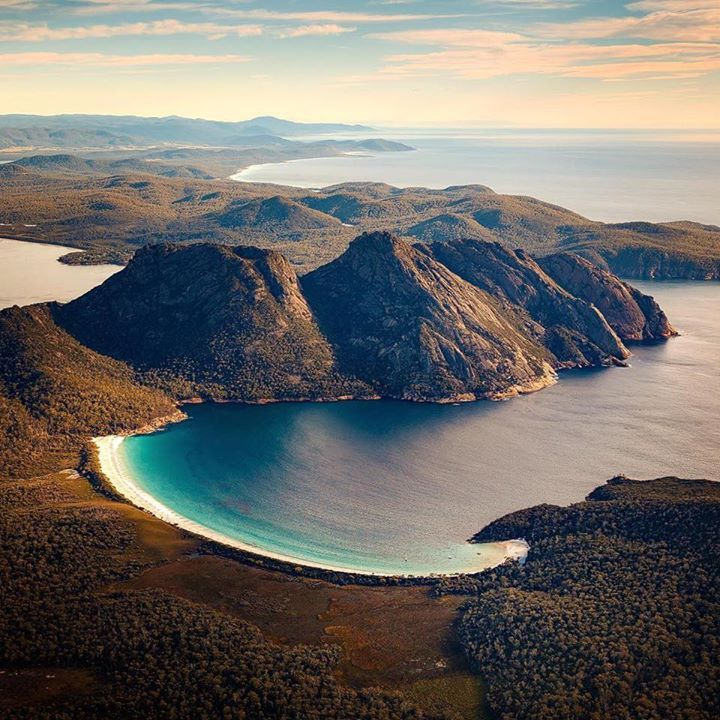 Wineglass Bay COLES BAY & THE FREYCINET PENINSULA, TASMANIA Coles Bay and…