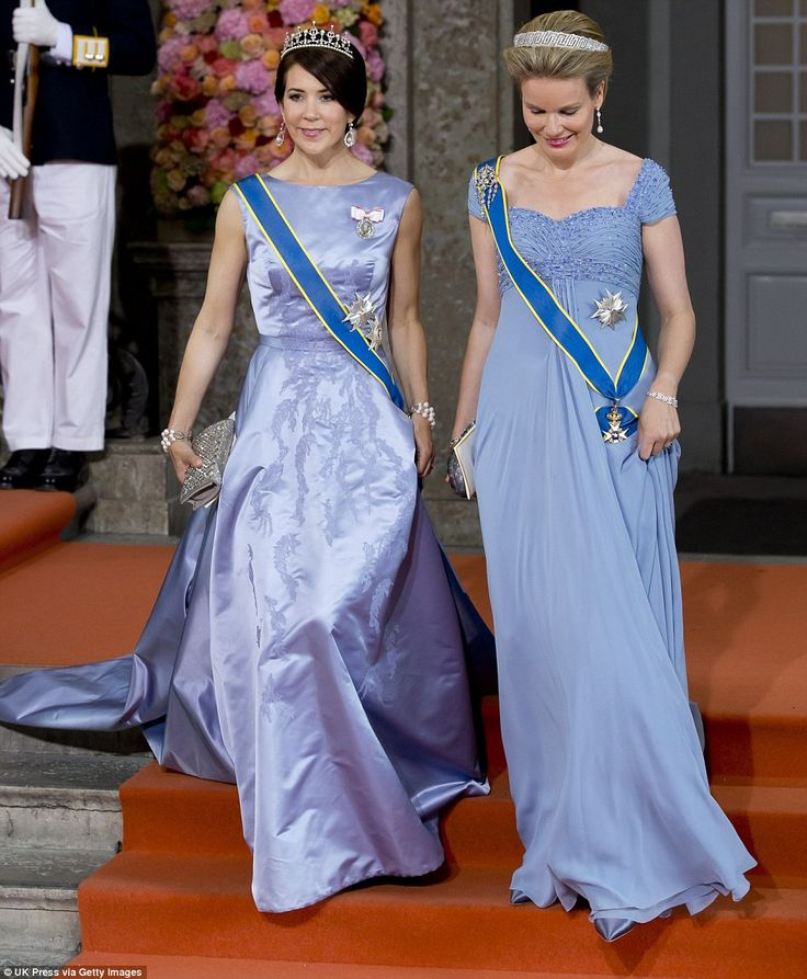 Princess Mary of Denmark (left) and Queen Mathilde of Belgium leave the Royal Chapel at Th...