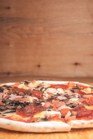 Where to eat when traveling South Africa - Get these delicious pizzas at a place called 'Cafe Bella' in East London!