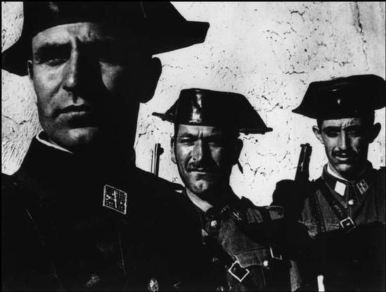 Members of the Guardia Civil, the rural police force in charge of patroling the Spanish countryside. SPAIN, 1951. Copyright: Magnum Photos