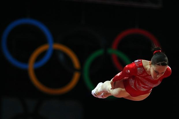 Katherine Driscoll of Britain competes in the qualifying for the women's gymnastics trampoline