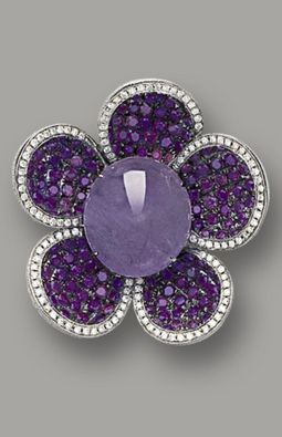 LAVENDER JADEITE AND DIAMOND RING Modelled as a flower, centring on a translucent lavender jadeite cabochon, to petals set with brilliant-cut treated purple diamonds together weighing approximately 1.60 carats, highlighted by brilliant-cut diamonds, mounted in 18 karat white gold