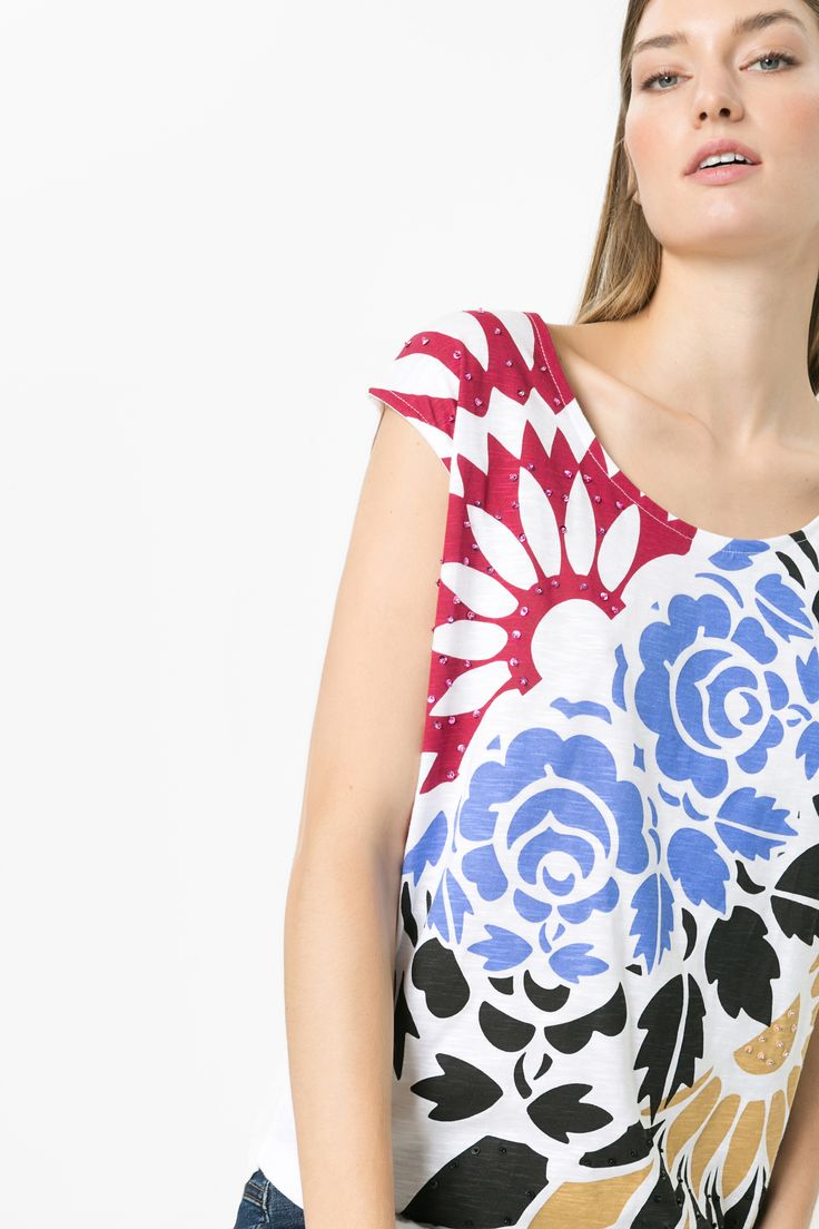 Plain white t-shirts are all good, but we like to twist it up at Desigual!