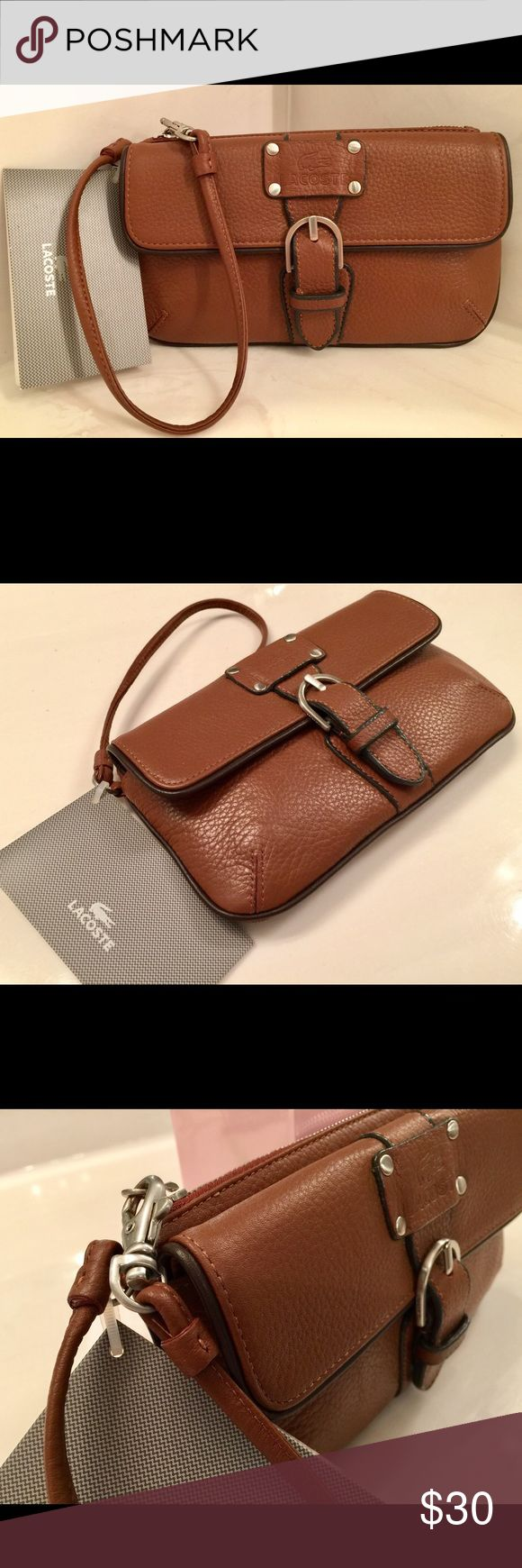 NWT Lacoste wristlet; pouch; ladies purse; handbag Lacoste women's wristlet; handheld bag; pouch; ladies purse. Exterior: soft brown leather with chocolate brown trim. Interior: fully lined in striped fabric for durability and cleanliness. Has 2 compartments (1 zippered and 1 snapped closure). Hardware: silver. Will fit iPhone plus. AUTHENTIC and new with tag. Lacoste Bags Clutches & Wristlets
