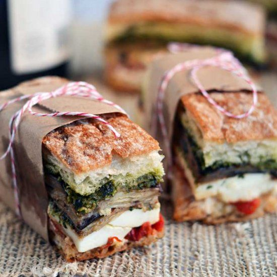 These Pressed Picnic Sandwiches are requested for every picnic and BBQ I attend. Can you guess what each layer is?