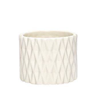 Porcelain Tealight Holder - White: Small white porcelain tealight candle holder with diamond pattern to help guide your way.