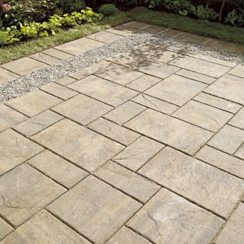 Backyard patio of concrete paving slabs with gravel insert