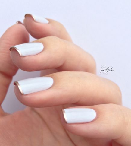 For this look, start with an opaque white nail and carefully add French tips with your favorite metallic polish. #NailArt #NailDesigns