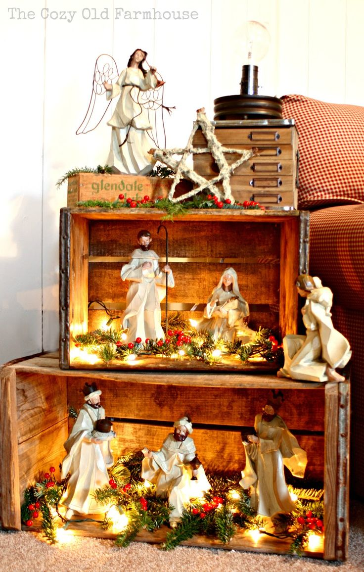 Such a pretty way to display a nativity... Or a Christmas village! Doing this next to our tree this year. I don't have room for the whole nativity set, but this will work.