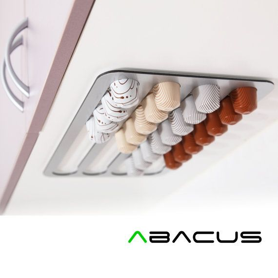 Abacus Pod Rack, a kitchen accessory that holds and dispenses your Nespresso coffee capsules