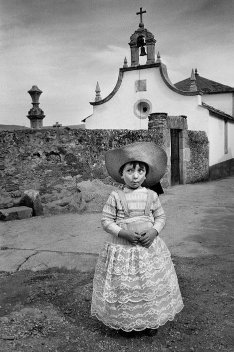 Cristina Garcia Rodero. SPAIN. Galicia. Viana do Bolo. Child with wide-brimmed hat.
