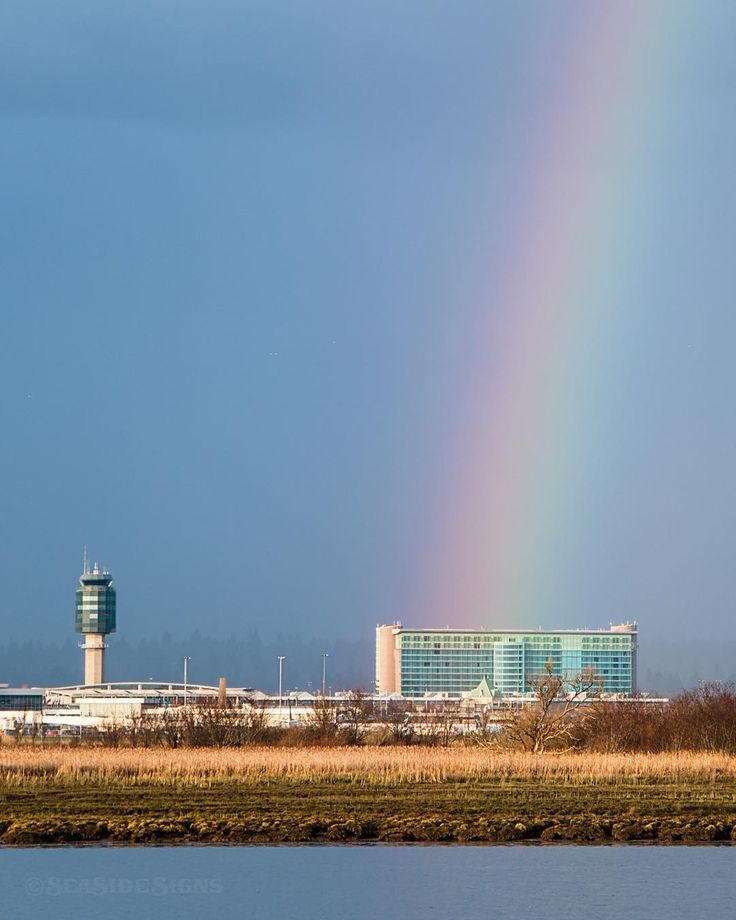 Aloha Vancouver  Sun showers over @YVRAirport paint a rainbow leading the way to Vancouver International's pot of gold @FairmontVancouverAirport  Voted # 1 Airport Hotel in North America and 6th in the world. Captured this evening in Richmond British Columbia Canada  February 27 2016