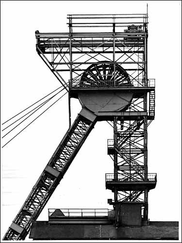 "Bernd & Hilla Becher - The German artists Bernd and Hilla Becher, who began working together in 1959 and married in 1961, are best known for their ""typologies""—grids of black-and-white photographs of variant examples of a single type of industrial structure. To create these works, the artists traveled to large mines and steel mills, and systematically photographed the major structures"