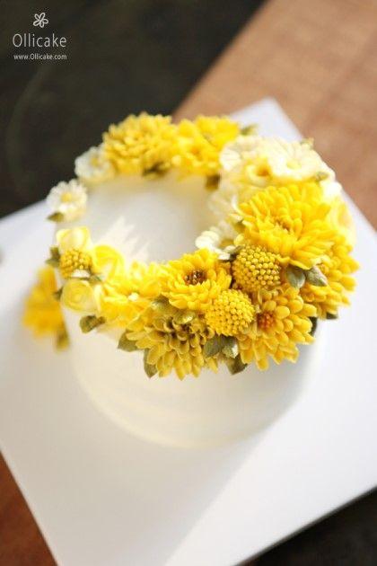 olliecake.com Beautiful cheery yellow Korean flower cake. Birthday Mother's day,  garden Party shower. Believe flowers were made of bean paste & conf sugar .