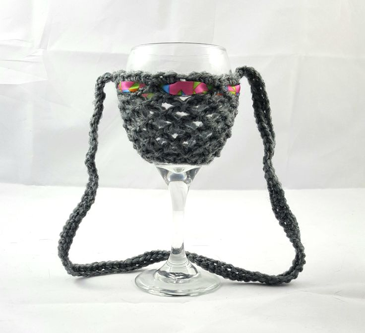 This wine glass necklace is perfect for the wine enthusiast! Fantastic stocking stuffer idea! Great for girls night out, bachelorette party, wedding favor, wine festivals, barbecues and more. No more worry about which wine glass is yours. A lovely crochet wine glass holder that sits nicely on the table or around your neck.  Created with acrylic yarn for stability and comfort.   Hand wash in cold water and hang dry to ensure long lasting wear.  *** Wine glass not included ***