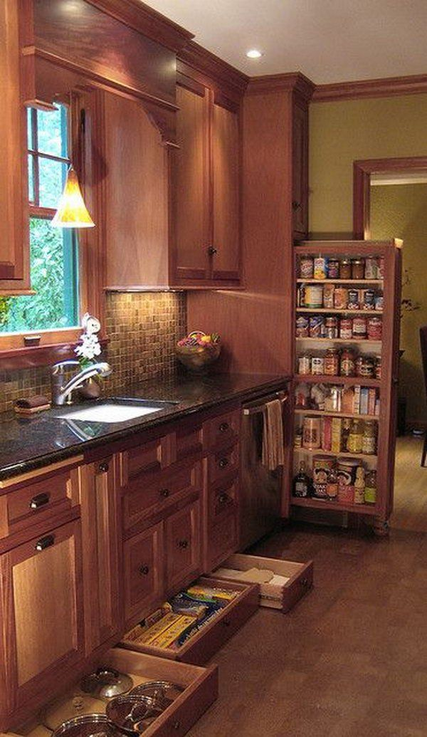 Narrow drawers underneath the cabinetry provide storage for narrow items such as cooking and pizza trays.
