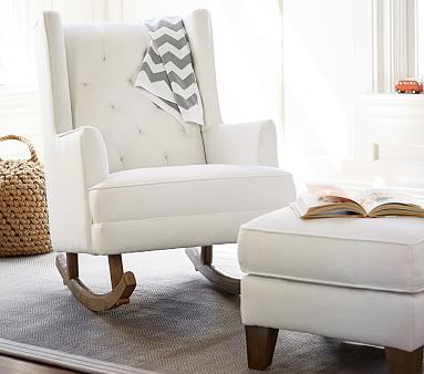 We crafted this plush rocking chair with nursing mothers' needs in mind. The padded headrest is extra supportive, and the winged back and smaller armrests offer more shoulder and elbow space.