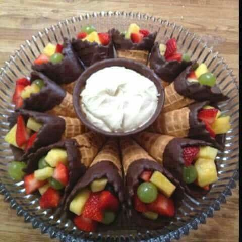 Saw this on Facebook. Dip waffle cones in chocolate add fruit, then make your favorite fruit dip. Fun way to serve fruit at get together's.