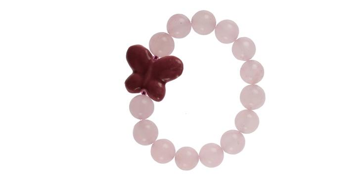 """Brățară elastică din bile nefațetate de Cuarț Roz (12 mm) și fluture din porțelan roz (30 mm). Face parte din colecția """"It's my party!"""" Bilele sunt din pietre naturale, de aceea nu pot fi identice și pot prezenta imperfecțiuni. Componentele din metal sunt din aliaje antialergice, nu conțin nichel și nici plumb, dar își pot schimba culoarea în timp sau în contact cu unele tipuri de piele."""