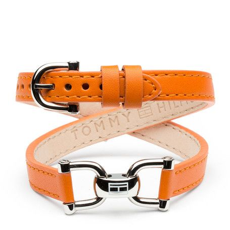 Gorgeous bracelet styled with an eye-catching stainless steel link with Tommy Hilfiger logo flag embossed in the centre. Cross-over leather straps in burnt orange with adjustable buckle complete the unique look. Logo embossed inside the leather strap.