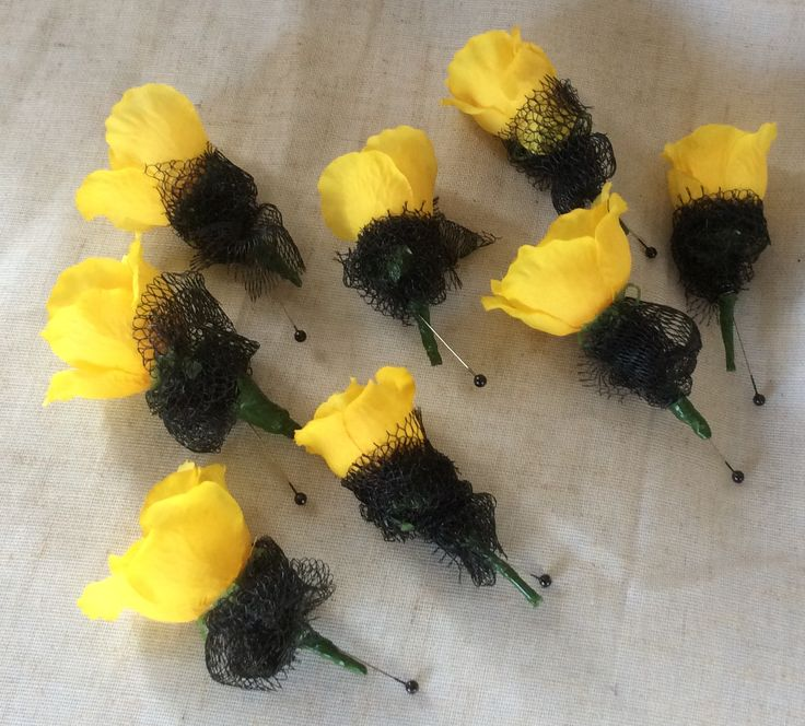 Yellow rose and black netting button holes by Cathey's flowers