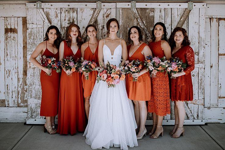 Laid-back Los Poblanos Wedding with Orange Bridesmaid Gowns - http://ruffledblog.com/laid-back-los-poblanos-wedding-with-orange-bridesmaid-gowns