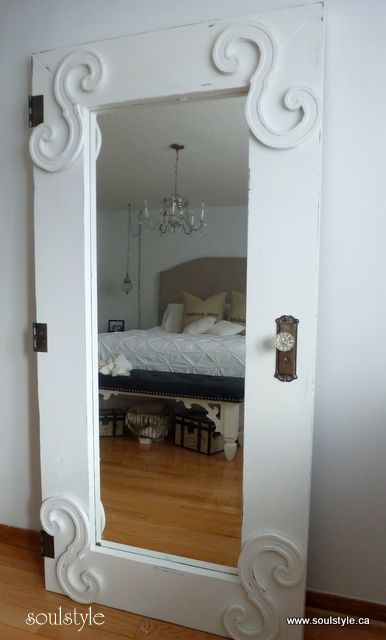 dress up a plain mirror to look like an old door