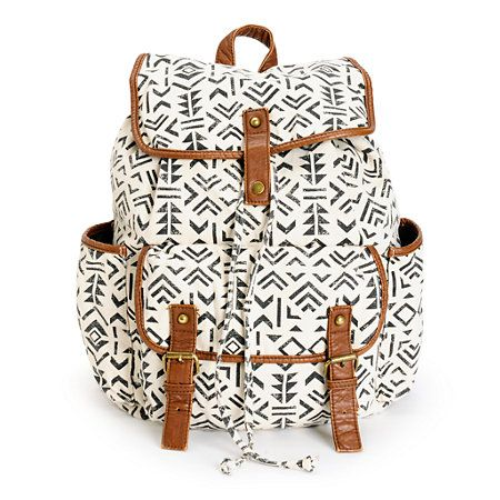 This rucksack backpack is designed with a large main compartment and plenty of pockets for ample storage space with the added style of the tribal print canvas exterior.