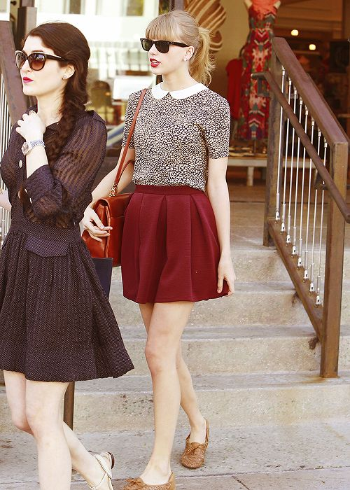 Yes! Love her. Red skirt, oxfords, and a Peter Pan collar top