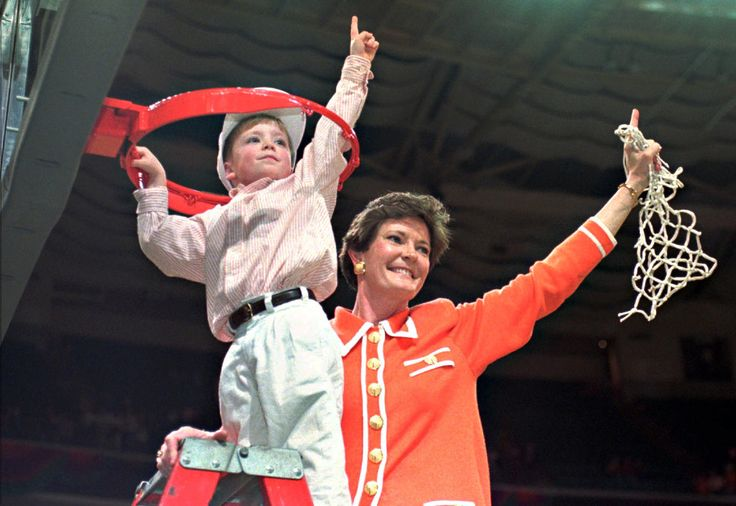 Tennessee coach Pat Summitt and son Tyler, 5, take down the net after winning the NCAA Women's Final Four against Georgia 83-65 at the Charlotte Coliseum in Charlotte, N.C., March 31, 1996. Summitt helped grow college women's basketball as her Lady Vols dominated the sport in the late 1980s and 1990s, winning six titles in 12 years. Tennessee -- the only school she coached -- won NCAA titles in 1987, 1989, 1991, 1996-98 and 2007-08. Summitt had a career record of 1,098-208 in 38 seasons…