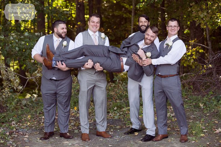 Funny photo of the groomsmen picking up the groom at this berkshires wedding.