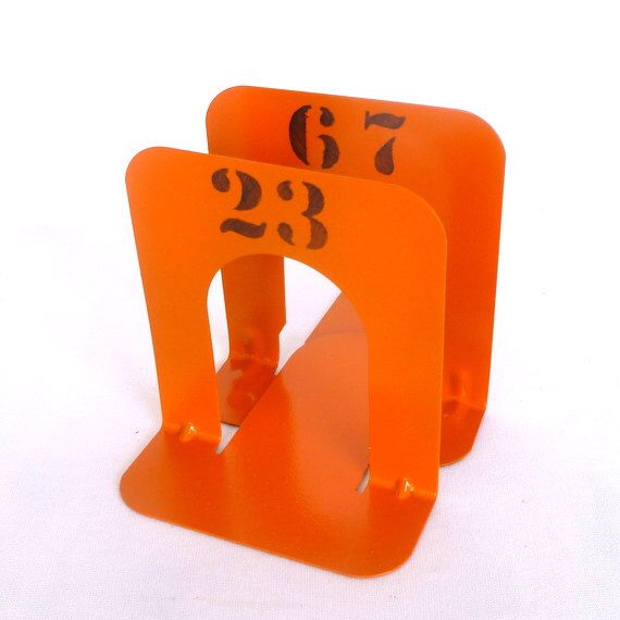 Small ORANGE INDUSTRIAL BOOKENDS by orangedoorvintage on Etsy https://www.etsy.com/listing/94462644/small-orange-industrial-bookends